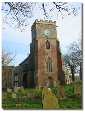 Denton Church tower, built out of brick and flint with a clock mounted high up